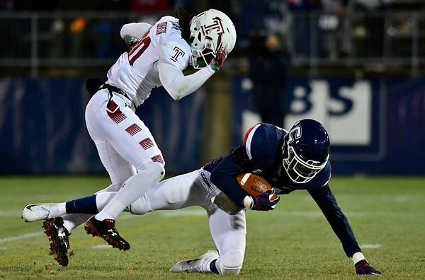 11/24/2018 Mike Orazzi | Staff UConn's Oneil Robison (31) and Temple's Freddie Johnson (80) during Saturday's football at Rentschler Field in East Hartford.