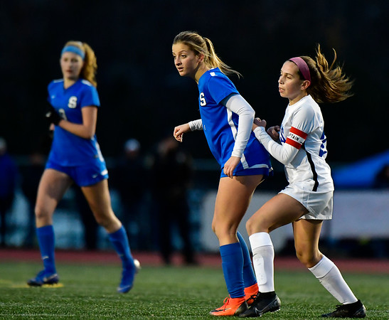 11/23/2019 Mike Orazzi | Staff Glastonbury High School's Alexandra Bedard (29) and Southington High School's Emma Panarella (7) during the Class LL Girls State Soccer Tournament at Veterans Stadium in New Britain Saturday evening. Glastonbury defeated Southington 1-0.