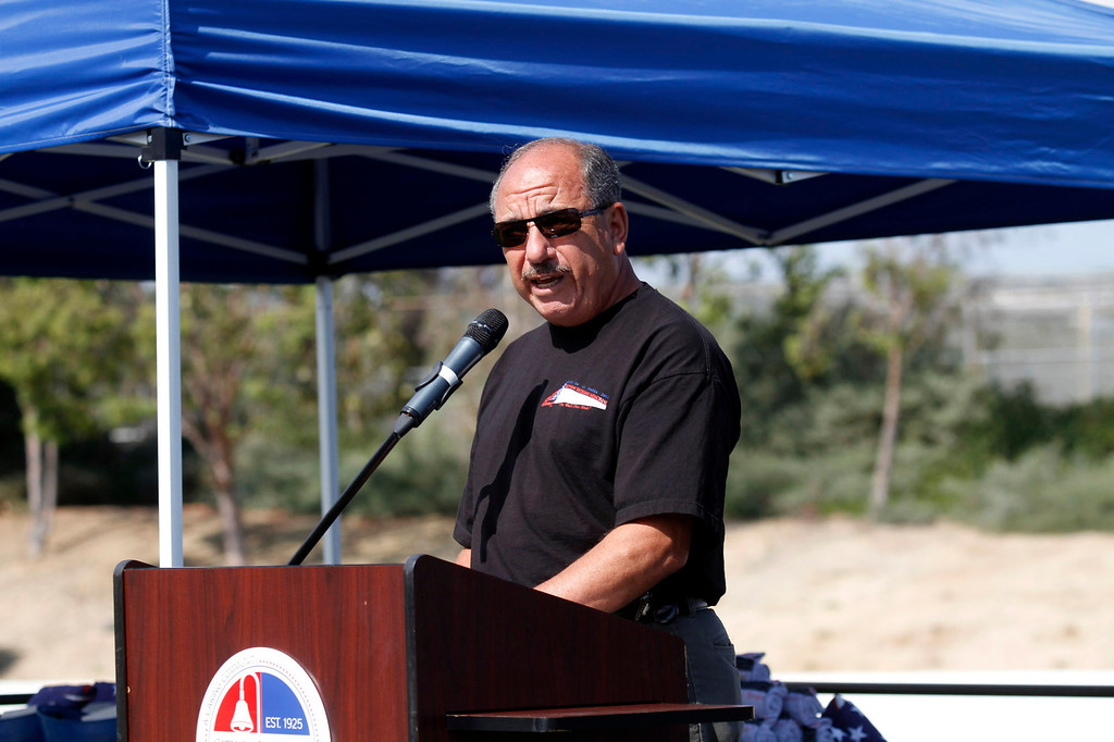 ". Raul Luna, a Vietnam Veteran, Purple Heart & Bronze Star Recipient, gives the introduction, during the Vietnam Veterans Memorial ""The Wall That Heals\"" Closing Ceremony event, at La Habra High School, in La Habra, Sunday, July 14, 2013. (SGVN/Correspondent Photo by James Carbone)"