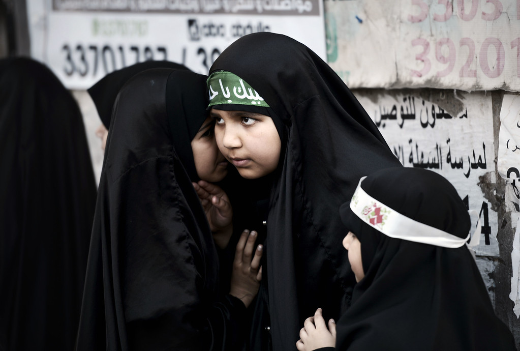 . Bahraini Shiite Muslim girls take part in a ceremony marking Ashura, which commemorates the seventh century slaying of Imam Hussein, the grandson of Prophet Mohammed, in the village of Sanabis, west of Manama on November 1, 2014. MOHAMMED AL-SHAIKH/AFP/Getty Images