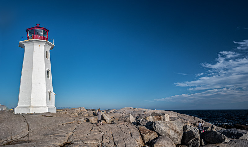woman walking toward Peggy's Point Lighthouse.jpg