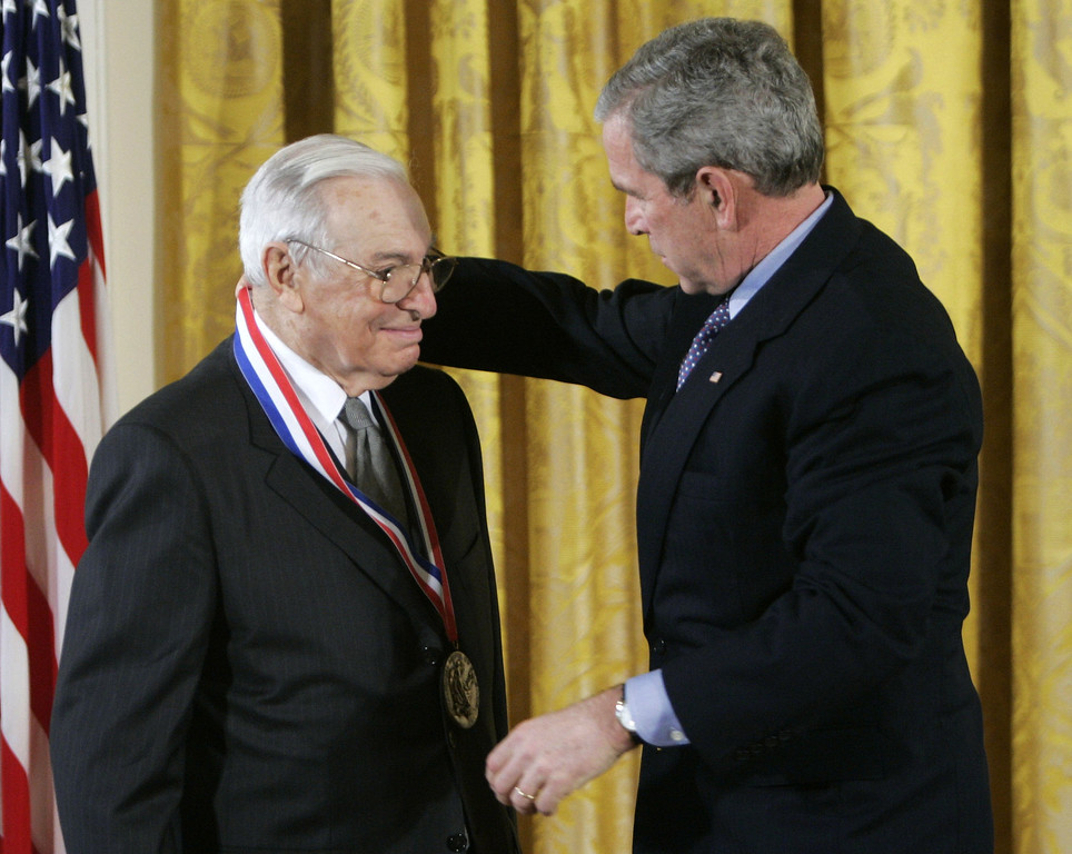 . FILE - This Feb. 13, 2006 file photo President George W. Bush, right, presents the National Medal of Science to Dr. Kenneth J. Arrow, left, from Stanford University, during a ceremony in the East Room of the White House in Washington. Arrow, the youngest ever winner of a Nobel prize for economics, has died. His son, David, says Arrow died on Tuesday, Feb. 21, 2017, at his home in Palo Alto. (AP Photo/Pablo Martinez Monsivais, File)