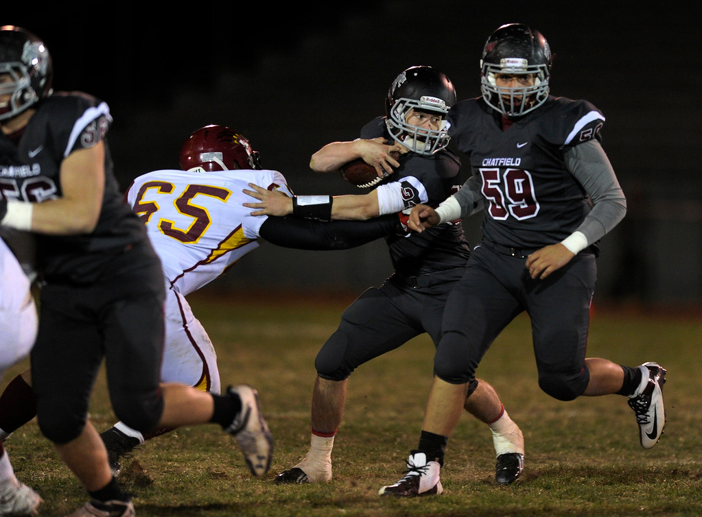 . Chatfield running back Michael Callahan-Harris (23) made a move past Lobos lineman Luiz Perez  (65) in the second half.  Photo By Karl Gehring/The Denver Post