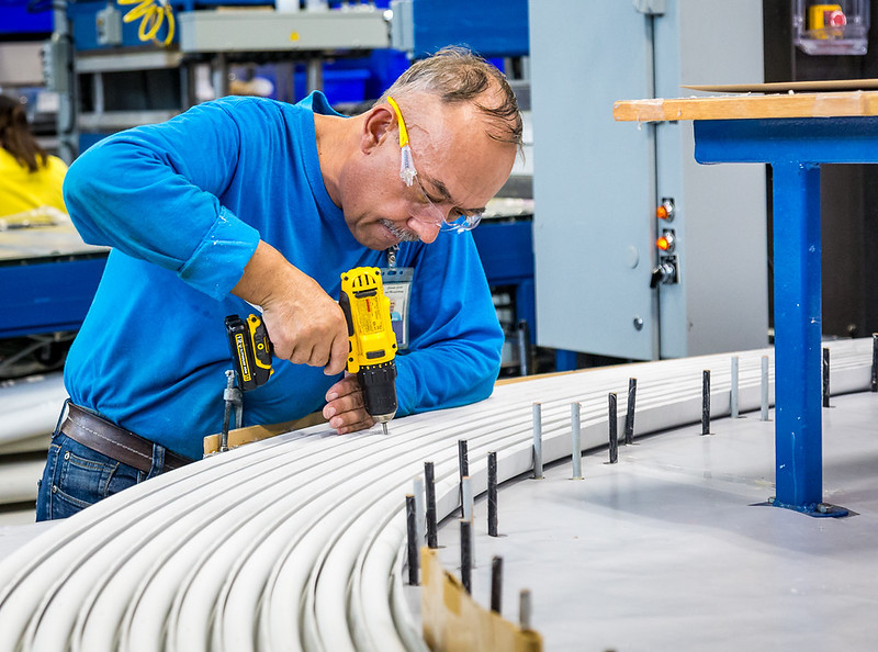 Technician drilling rubber gasket material.
