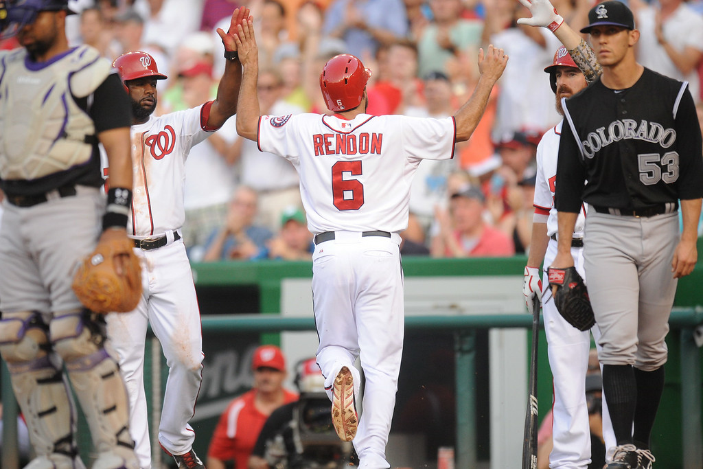 . Anthony Rendon #6 of the Washington Nationals celebrates scoring the National\'s first run on a Jayson Werth (not pictured) double in the first inning during a baseball against the Colorado Rockies on July 1, 2014 at Nationals Park in Washington, DC.  (Photo by Mitchell Layton/Getty Images)