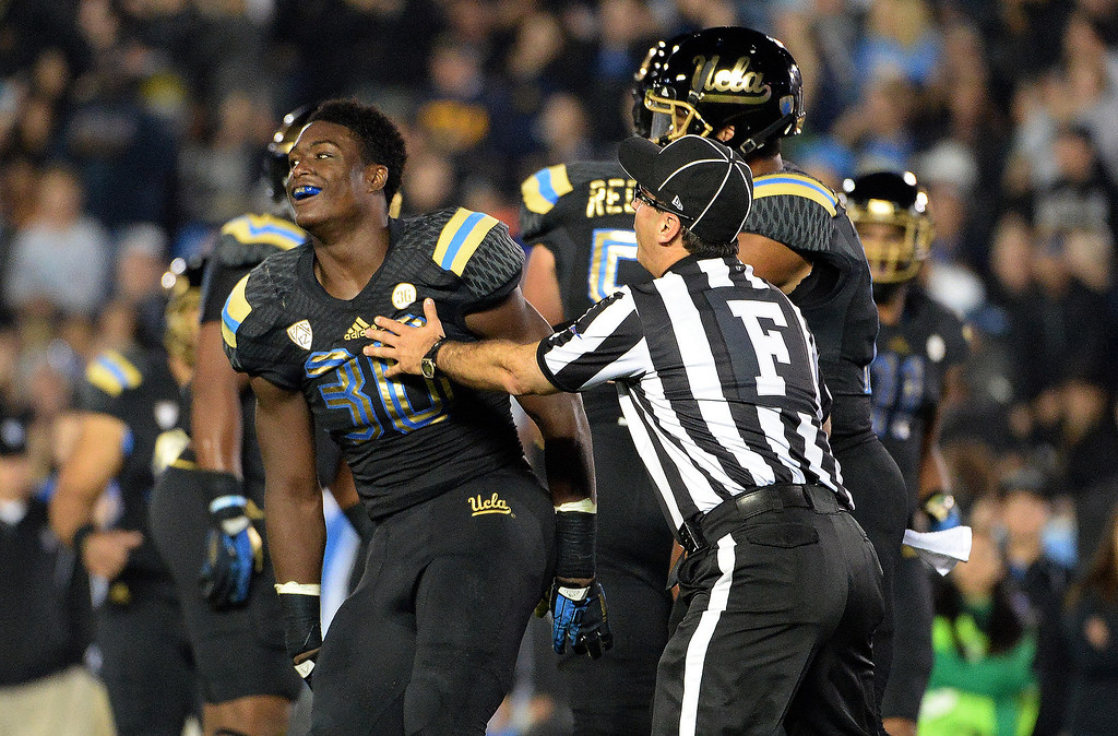 . UCLA Bruin running back Myles Jack (30) reacts after scoring one of his four touchdowns against Washington Huskies during the first half of their college football game in the Rose Bowl in Pasadena, Calif., on Friday, Nov. 15, 2013.   (Keith Birmingham Pasadena Star-News)