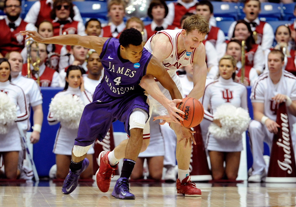 . DAYTON, OH - MARCH 22: Charles Cooke #4 of the James Madison Dukes and Cody Zeller #40 of the Indiana Hoosiers go for a loose ball in the second half during the second round of the 2013 NCAA Men\'s Basketball Tournament at UD Arena on March 22, 2013 in Dayton, Ohio.  (Photo by Jason Miller/Getty Images)