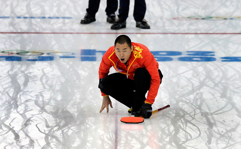 . China\'s skip Liu Rui shouts instructions to his teammates during the men\'s curling bronze medal game against Sweden at the 2014 Winter Olympics, Friday, Feb. 21, 2014, in Sochi, Russia. (AP Photo/Wong Maye-E)