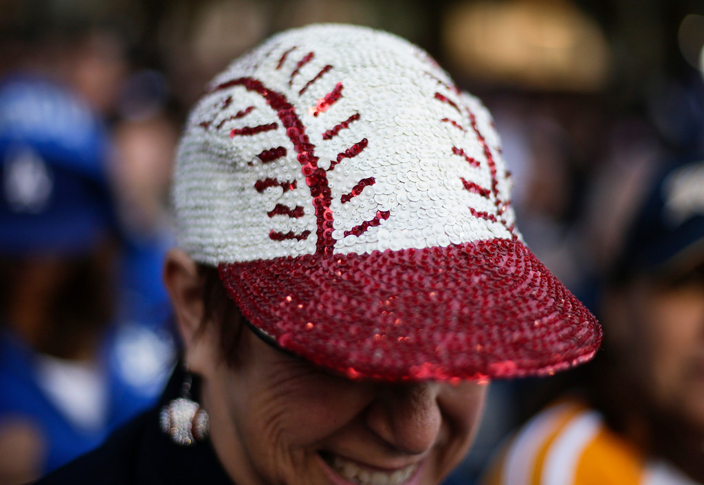. Cindy Keltner wears a baseball hat as the Los Angeles Dodgers play the San Diego Padres during an opening night baseball game on Sunday, March 30, 2014, in San Diego. (AP Photo/Gregory Bull)