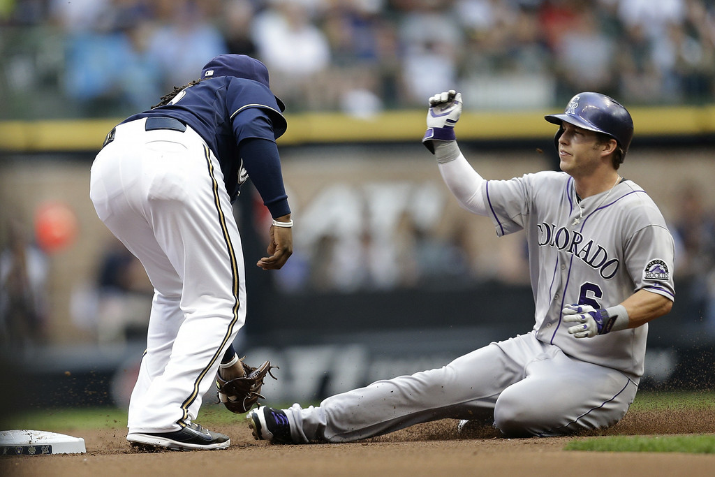 . MILWAUKEE, WI - JUNE 27: Rickie Weeks #23 of the Milwaukee Brewers makes the tag as Corey Dickerson #6 of the Colorado Rockies tries stealing second base in the top of the second inning at Miller Park on June 27, 2014 in Milwaukee, Wisconsin. (Photo by Mike McGinnis/Getty Images)