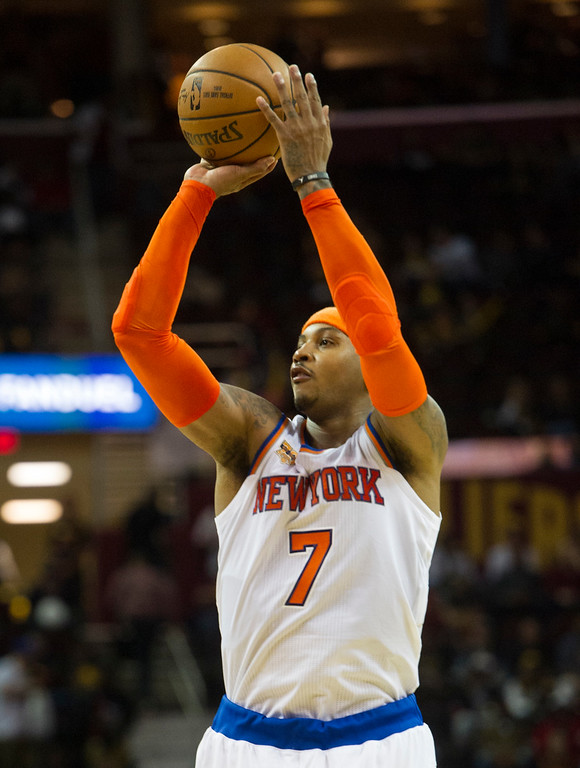 . New York Knicks\' Carmelo Anthony takes a shot against the Cleveland Cavaliers during the second half of an NBA basketball game in Cleveland, Tuesday, Oct. 25, 2016. (AP Photo/Phil Long)
