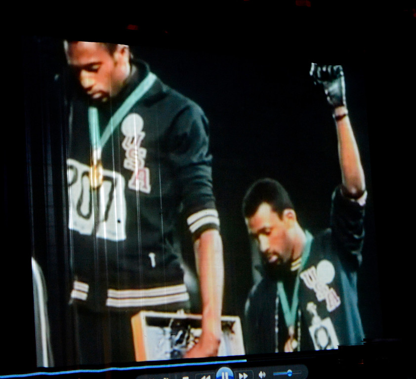 . The iconic image was shown to San Bernardino High School students of Gold medalist Tommie Smith, left, and Bronze Medalist John Carlos, right,  as they raised their fists  in a Black Power salute during their medals ceremony in the 1968 Olympic Games in Mexico.  GABRIEL LUIS ACOSTA/STAFF PHOTOGRAPHER.