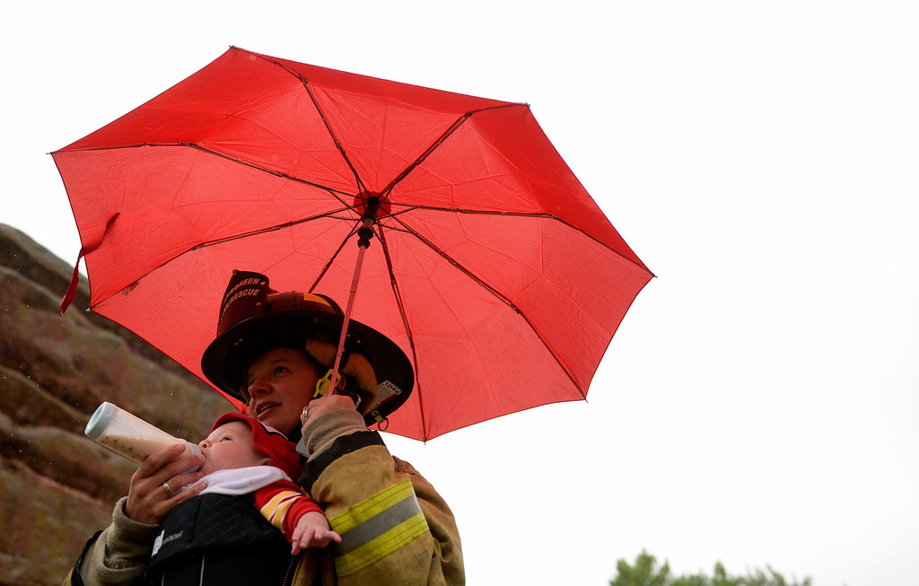 . Firefighter Jenn Ray, of Evergreen Fire Department, feeds her son, Dylan, as they prepare to do the 911 Stair Climb at Red Rocks Amphitheater to honor the people and events of 9/11, September 11, 2013.  (Photo By RJ Sangosti/The Denver Post)