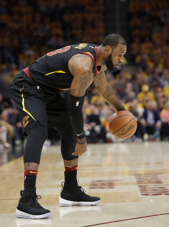 . Cleveland Cavaliers\' LeBron James (23) catches his breath against the Boston Celtics in the first half of Game 3 of the NBA basketball Eastern Conference finals, Saturday, May 19, 2018, in Cleveland. (AP Photo/Tony Dejak)