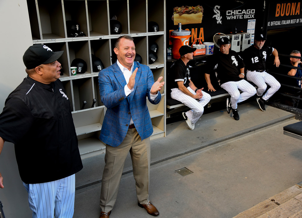 . Chicago White Sox great Jim Thome talks with hitting coach Todd Steverson, left, before the team\'s baseball game against the Cleveland Indians on Saturday, Aug. 11, 2018, in Chicago. Thome was inducted into the Baseball Hall of Fame earlier this year.  (AP Photo/Matt Marton)