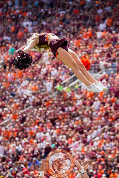 A Tech cheerleader is tossed in the air during a timeout at the game against Old Dominion University in Lane Stadium on Saturday, Sept. 7, 2019. (Photo: Cory Hancock)