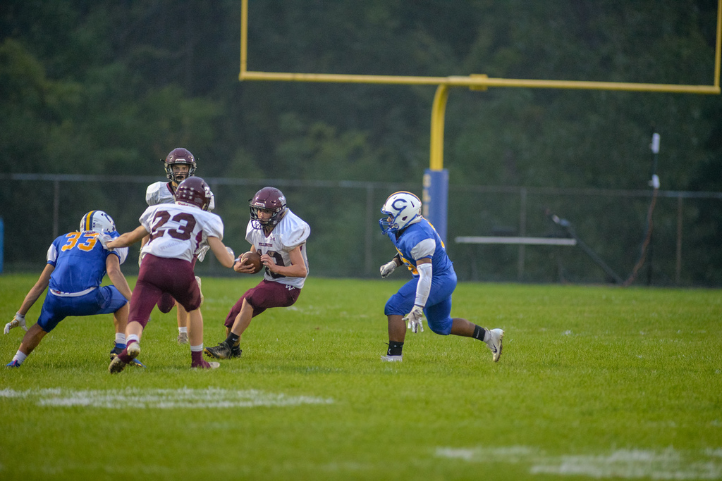 . Aimee Bielozer - The Morning Journal<br> Wellington\'s Jonathan Brasee cuts through the Clearview defense on Sept. 14.