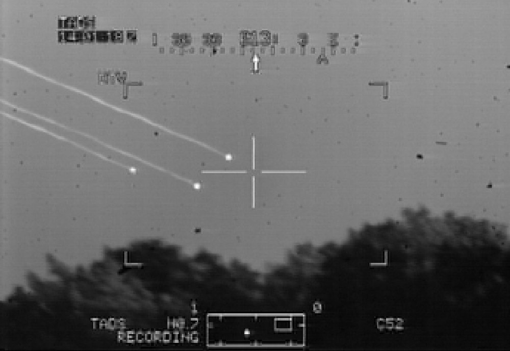 . Debris from the space shuttle Columbia is shown falling in this image from a U.S. Army Apache helicopter military video released February 12, 2003. Two Dutch military pilots training out of Fort Hood, Texas shot the video of the shuttle breaking up in flight February 1 as it returned from an orbital mission.  (Photo by Getty Images)
