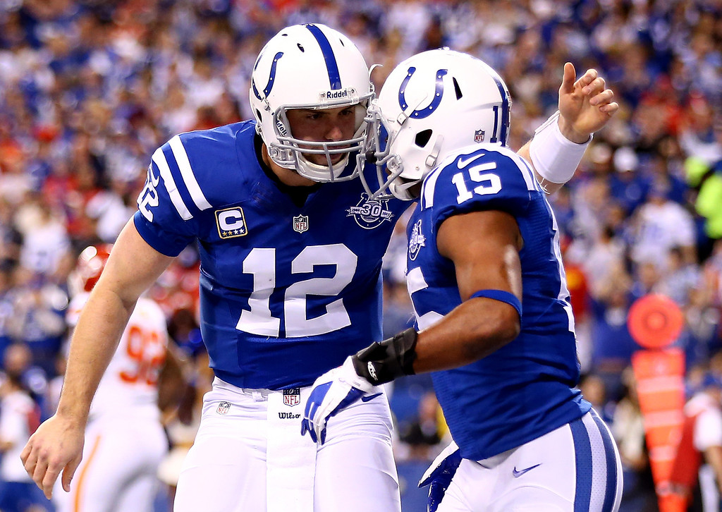 . INDIANAPOLIS, IN - JANUARY 04: Quarterback Andrew Luck #12 celebrates with wide receiver LaVon Brazill #15 of the Indianapolis Colts against the Kansas City Chiefs during a Wild Card Playoff game at Lucas Oil Stadium on January 4, 2014 in Indianapolis, Indiana.  (Photo by Andy Lyons/Getty Images)