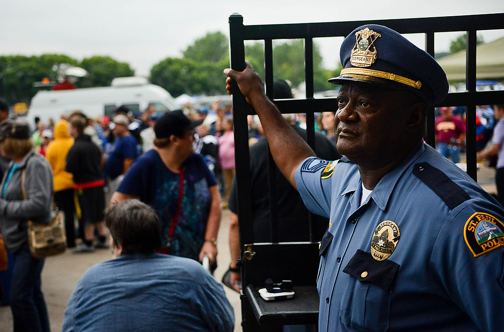 . Head of security St. Paul Police Sgt. Tyrone Strickland, who started with the Saints in 1994, stands guard at the entrance. He\'s retiring from the force Sept. 30. (Pioneer Press: Ben Garvin)