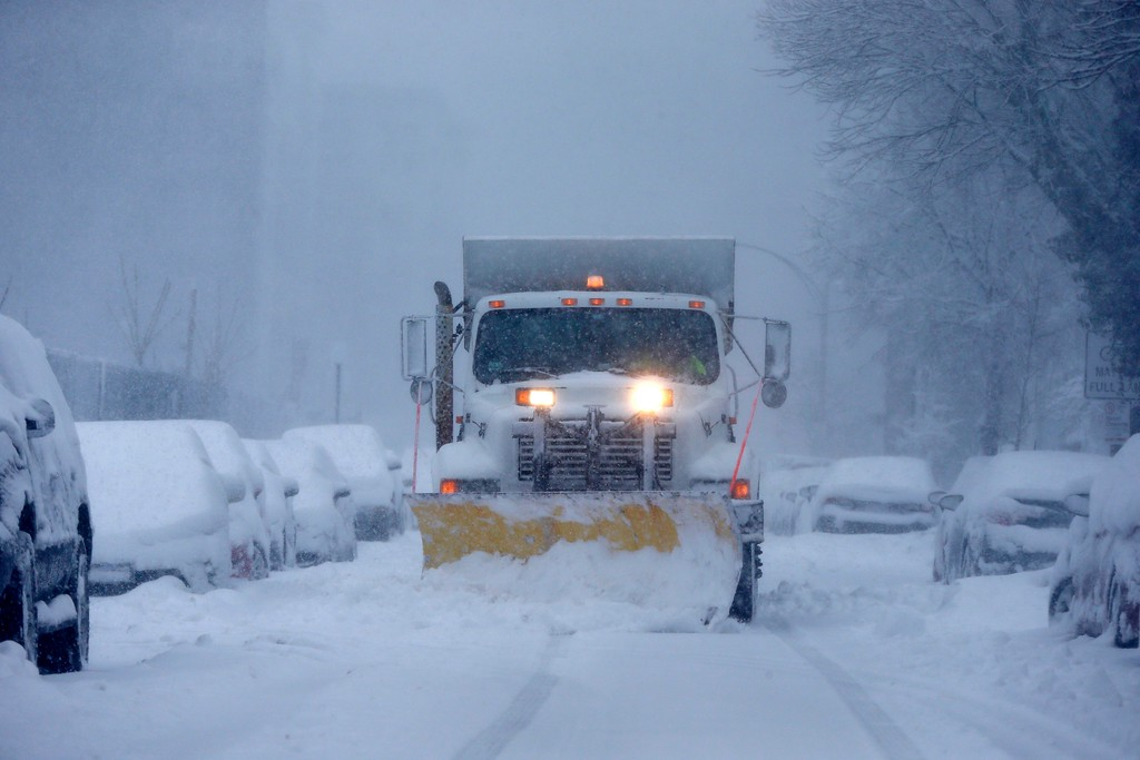 . A plow clears Marginal Street in Boston, Tuesday, March 13, 2018. Boston finds itself in the bullseye of the third nor\'easter in two weeks, with forecasters warning of up to 18 inches of snow and 2 feet or more to the south. (AP Photo/Michael Dwyer)