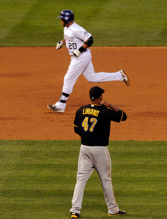 . DENVER, CO. - AUGUST 09: Pirates starting pitcher Francisco Liriano watched as Wilin Rosario rounded the bases after a second inning home run. The Colorado Rockies hosted the Pittsburgh Pirates Friday night, August 9, 2013. Photo By Karl Gehring/The Denver Post