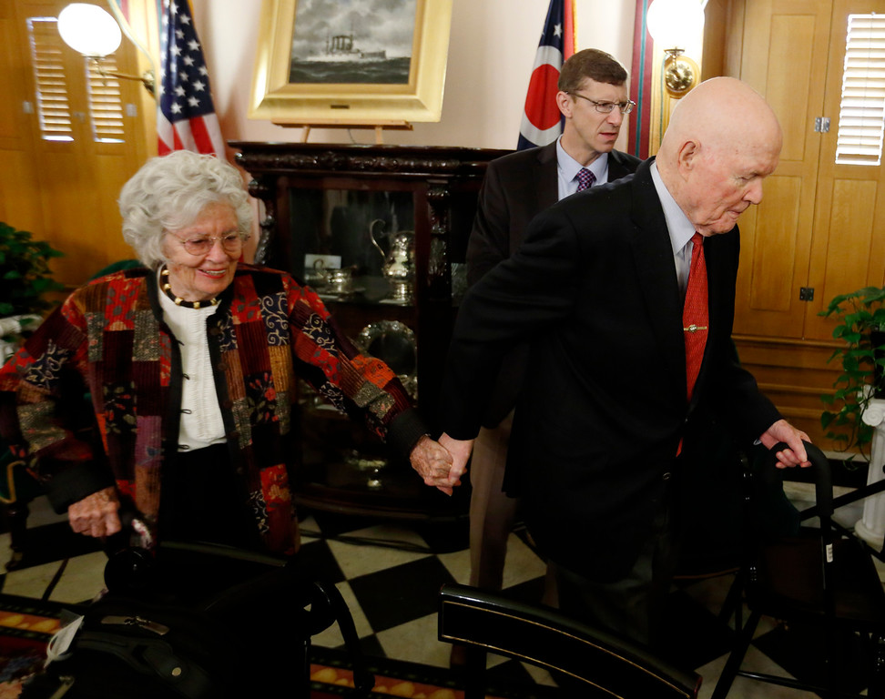 . Former astronaut and U.S. Sen. John Glenn, right, and his wife Annie, left, leave a news conference along with Trevor Brown, Dean of the John Glenn College of Public Affairs at Ohio State University Thursday, May 14, 2015 at the Ohio Statehouse in Columbus.  Glenn announced Ohio\'s first-in-the-nation participation in an interactive civics education website. It will be administered by the John Glenn College of Public Affairs at Ohio State University. (AP Photo/Paul Vernon)