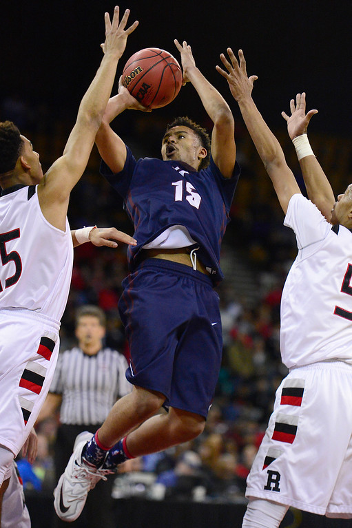 . Cherokee Trail forward Ronnie Barfield (15) takes a shot under pressure from Rangeview at the Denver Coliseum on March 5, 2016 in Denver, Colorado. Rangeview defeated Cherokee Trail 75-64 to advance to the semifinals in the Class 5A Colorado state basketball tournament. (Photo by Brent Lewis/The Denver Post)