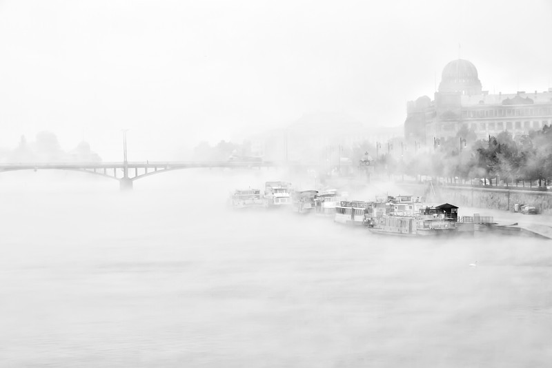 Hide and seek  Was feeling a little more artistic yesterday and this is the result :). There is something about minimalism B&W photos, which I really like, but usually can't create a nice one. Maybe this time :)  This photo was taken early in the morning from one of the bridges in Prague. I went out trying to take few shots of the sunrise, and a very heavy fog came over the city. You couldn't really see anything :)  No HDR here. I took three shots, but what I did was, that I took the overexposed photo, converted it to B&W using Silver effects and than played a little with curves in Photoshop.  Single photo, taken with Canon 7D with Sigma 18-200mm lens, from a tripod.