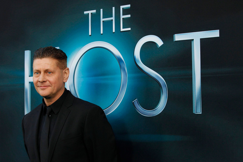""". Director Andrew Niccol poses at the premiere of \""""The Host\"""" in Hollywood, California March 19, 2013. The movie opens in the U.S. on March 29. REUTERS/Mario Anzuoni"""