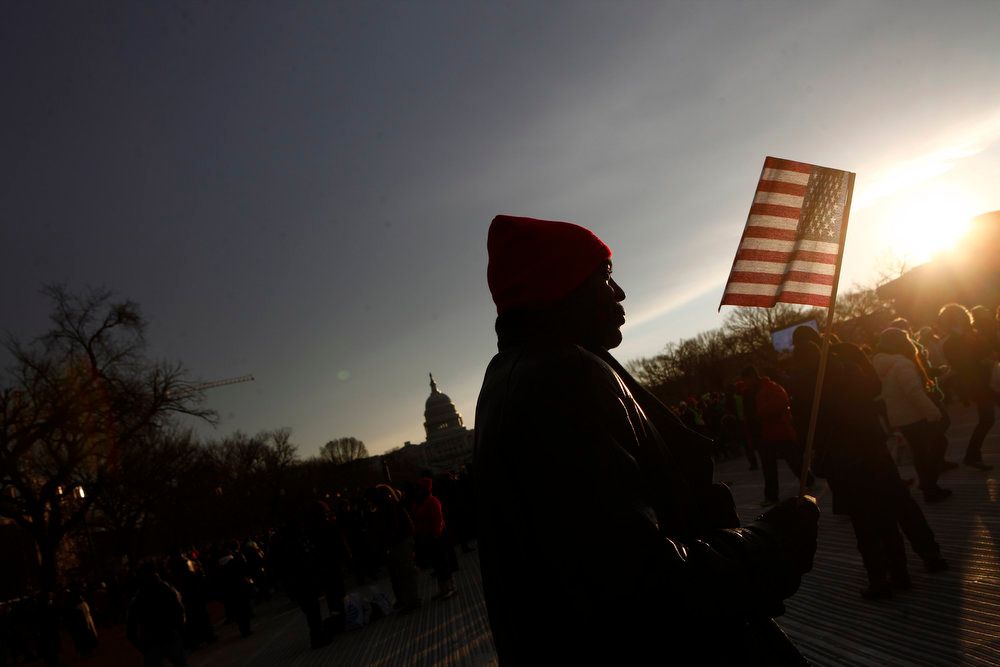 . A man walks on the National Mall before the 57th inauguration ceremonies for U.S. President Barack Obama and Vice President Joe Biden on the West front of the U.S. Capitol, in Washington January 21, 2013. REUTERS/Eric Thayer