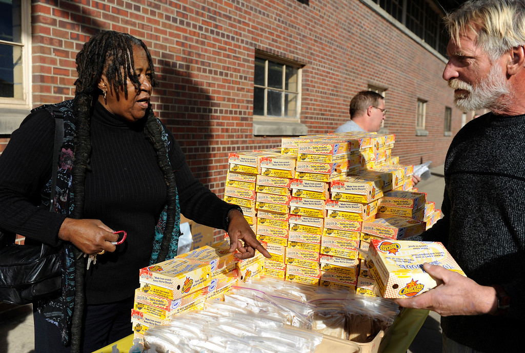 . The Emily Griffith Foundation along with extra assistance from Essie Garrett, left, collected donations from employees of the Emily Griffith Opportunity School to buy nearly 300 lunches for those less fortunate and the folks from nearby homeless shelters. Kathryn Scott Osler, The Denver Post