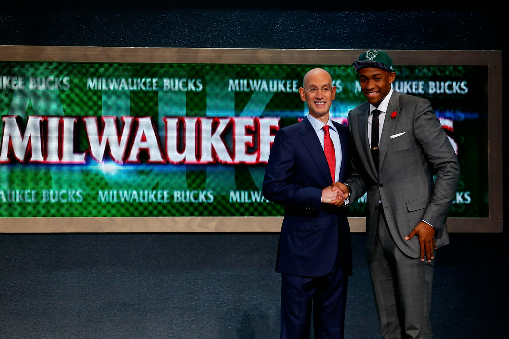 . Jabari Parker (R) of Duke poses for a photo with NBA Commissioner Adam Silver after Parker was drafted #2 overall in the first round by the Milwaukee Bucks during the 2014 NBA Draft at Barclays Center on June 26, 2014 in the Brooklyn borough of New York City.   (Photo by Mike Stobe/Getty Images)