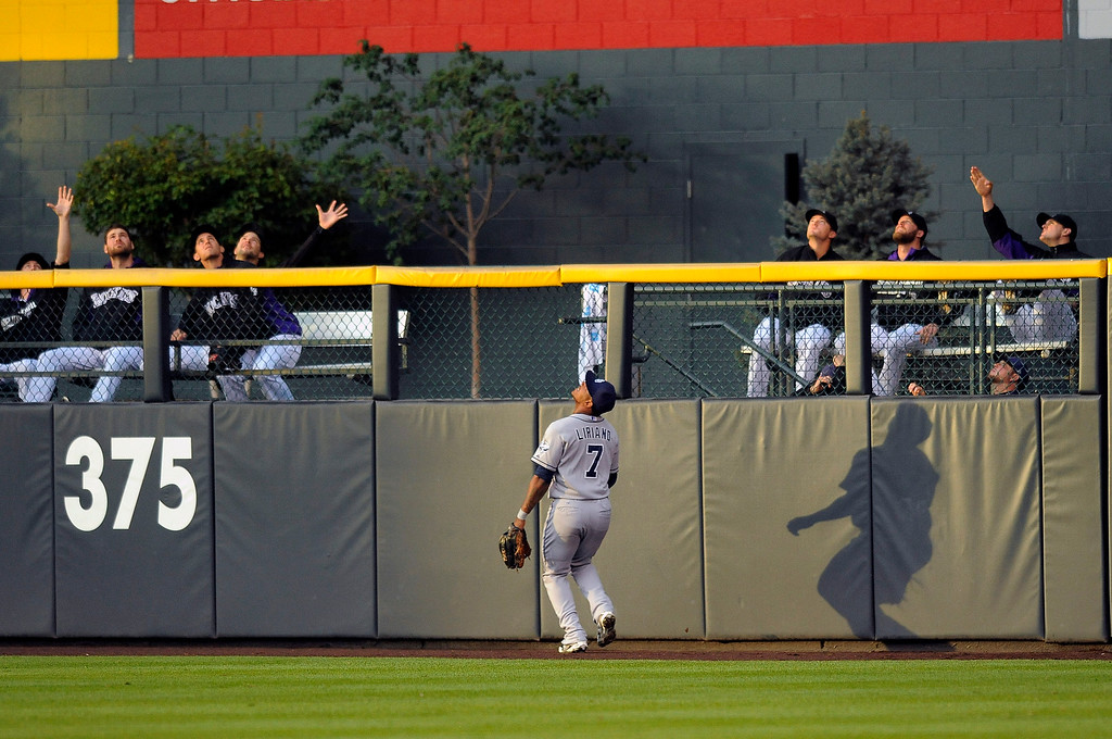 . San Diego Padres right fielder Rymer Liriano watches a home run by Colorado Rockies\' Drew Stubbs sail over the wall in the first inning of a baseball game Friday, Sept. 5, 2014, in Denver. The Rockies won 3-0. (AP Photo/Chris Schneider)