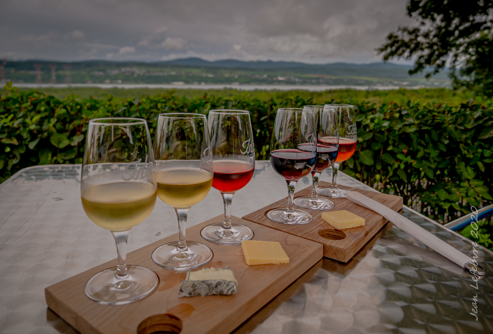 Six wine glasses with cheese