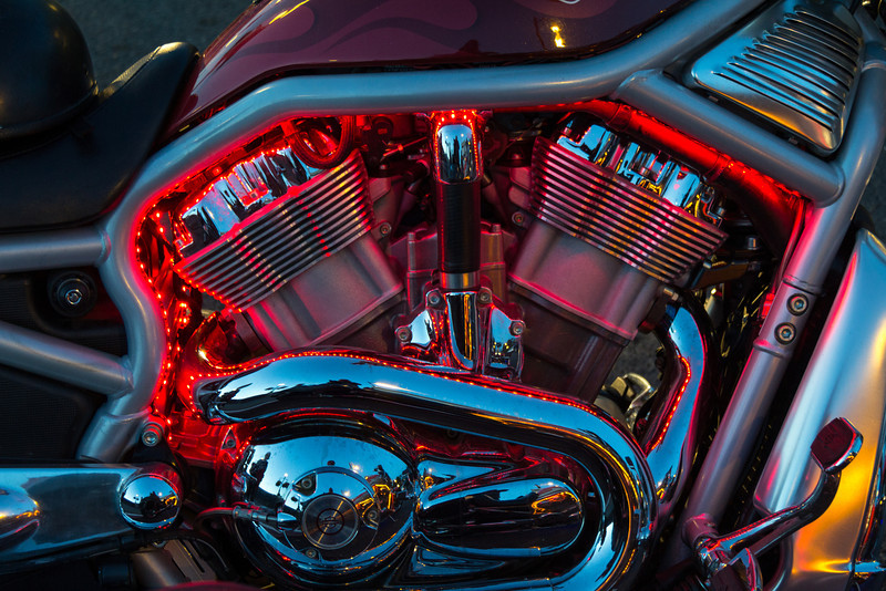 One of three neon-laced Harleys on a street in Victoria, B.C.