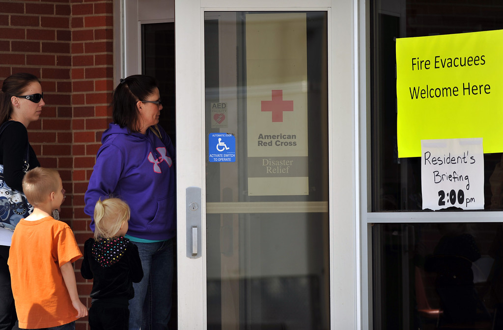 . FORT COLLINS, CO. - MARCH 16: Evacuees walk into the Cache La Pourdre Schools gymnasium for the resident\'s briefing. William Nelson, Larimer Under Sheriff, told homeowners evacuated by the Gelena wildfire that they can return to their homes by 8 p.m. Saturday. Fort Collins, Colorado. March 16, 2013. (Photo By Hyoung Chang/The Denver Post)