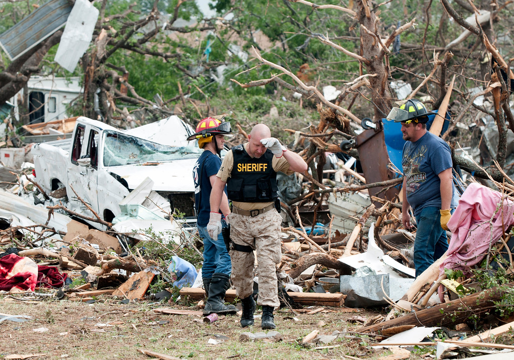 . Emergency personnel look through debris on near Granbury, Texas  on Thursday, May 16, 2013. (AP Photo/Rex C. Curry)