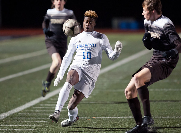 11/14/18 Wesley Bunnell | Staff Plainville #23 vs Stonington #3 soccer in the Class M Semifinal at Xavier High School on Wednesday night. Dane Stephens (10).