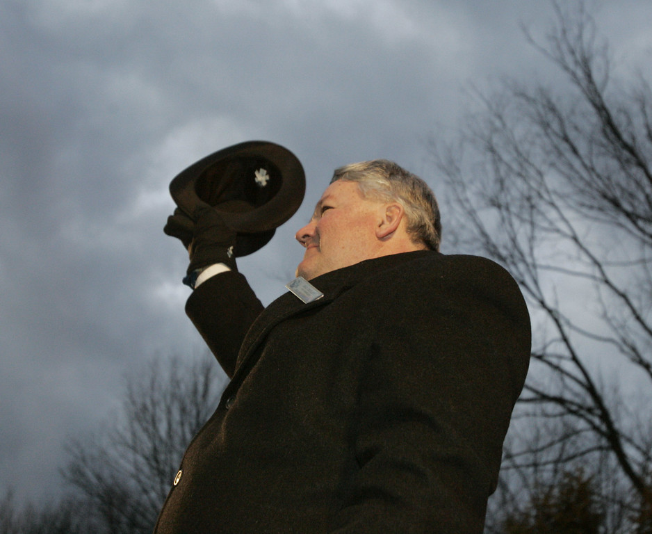 . Punxsutawney Phil\'s handler Bill Deeley waves to the crowd before the groundhogs  prediction of six more weeks of winter in Punxsutawney, Pa. on Thursday, Feb. 2, 2006. Deeley will be retiring as the official handler of Phil. (AP Photo/Keith Srakocic)