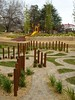 maze with block work paths and timber poles and sandstone block retaining and slide on mound