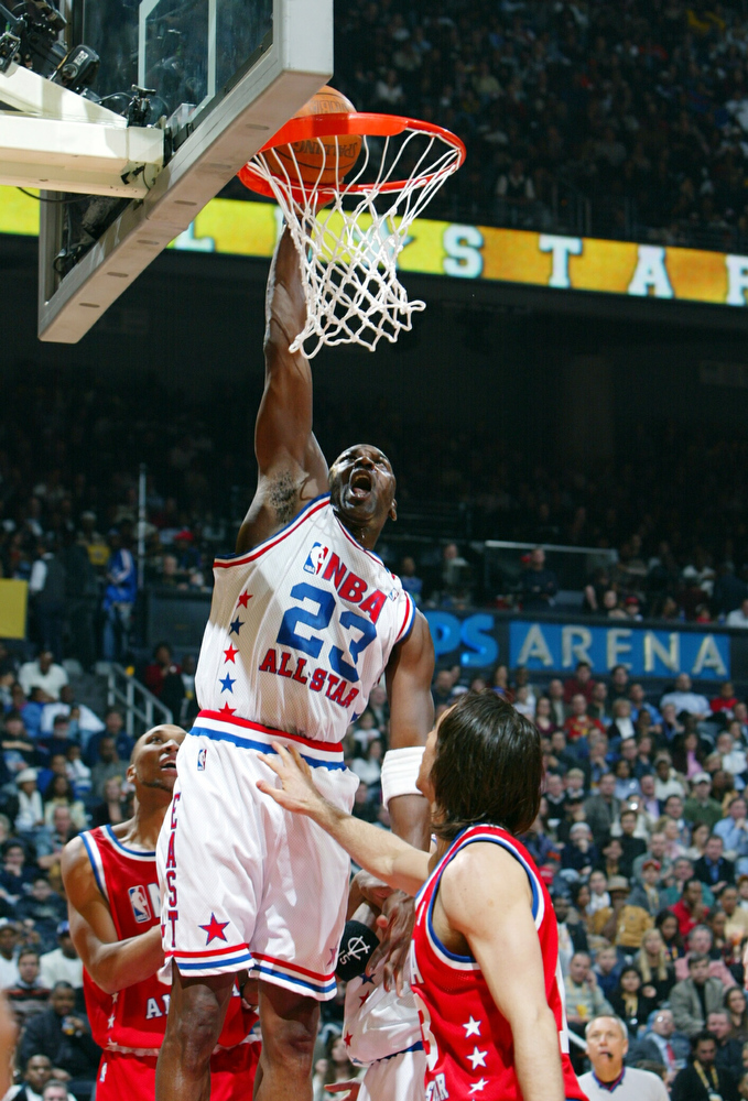. ATLANTA, GA - FEBRUARY 9: Michael Jordan of the Eastern Conference All-Stars dunks against the Western Conference All-Stars during the 2003 NBA All-Star Game on February 9, 2003 at Philips Arena in Atlanta, Georgia.   (Photo by Jamie Squire/Getty Images)