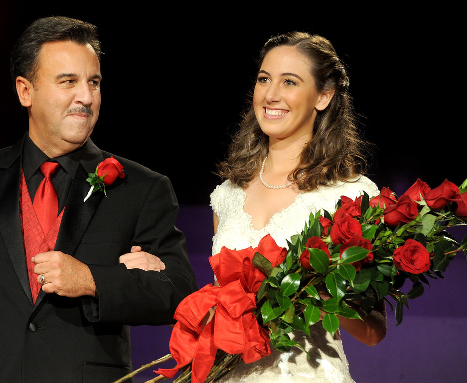 . Ana Marie Acosta, 17, father Dr. John H. Acosta walking with his daughter, Ana Marie Acosta who was name Tournament of Roses Announcement and Coronation of the 96th Rose Queen and Presentation of the 2014 Royal Court held at First Church of the Nazarene of PasadenaThursday, October 24, 2013. (Photo by Walt Mancini/Pasadena Star-News)