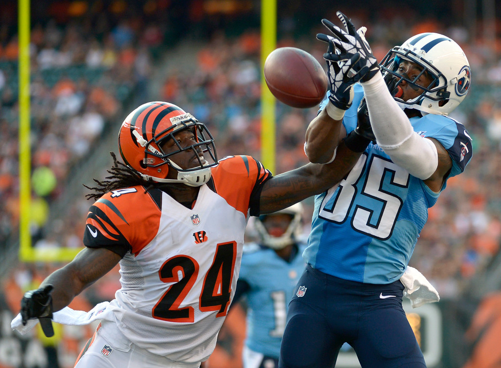 . Cincinnati Bengals cornerback Adam Jones (24) breaks up a pass intended for Tennessee Titans wide receiver Nate Washington (85) in the first half of an NFL preseason football game, Saturday, Aug. 17, 2013, in Cincinnati. (AP Photo/Michael Keating)