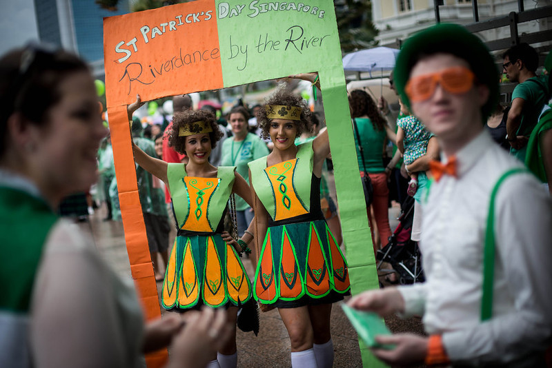 . People dressed in costume wait for the parade to start during the Singapore St. Patricks Day Street Festival at Boat Quay on March 17, 2013 in Singapore. Singapore\'s Irish community gathered at Boat Quay for a three-day-long St. Patrick\'s Day Street Festival which featured street performances, buskers, and Irish food and drink.  (Photo by Chris McGrath/Getty Images)