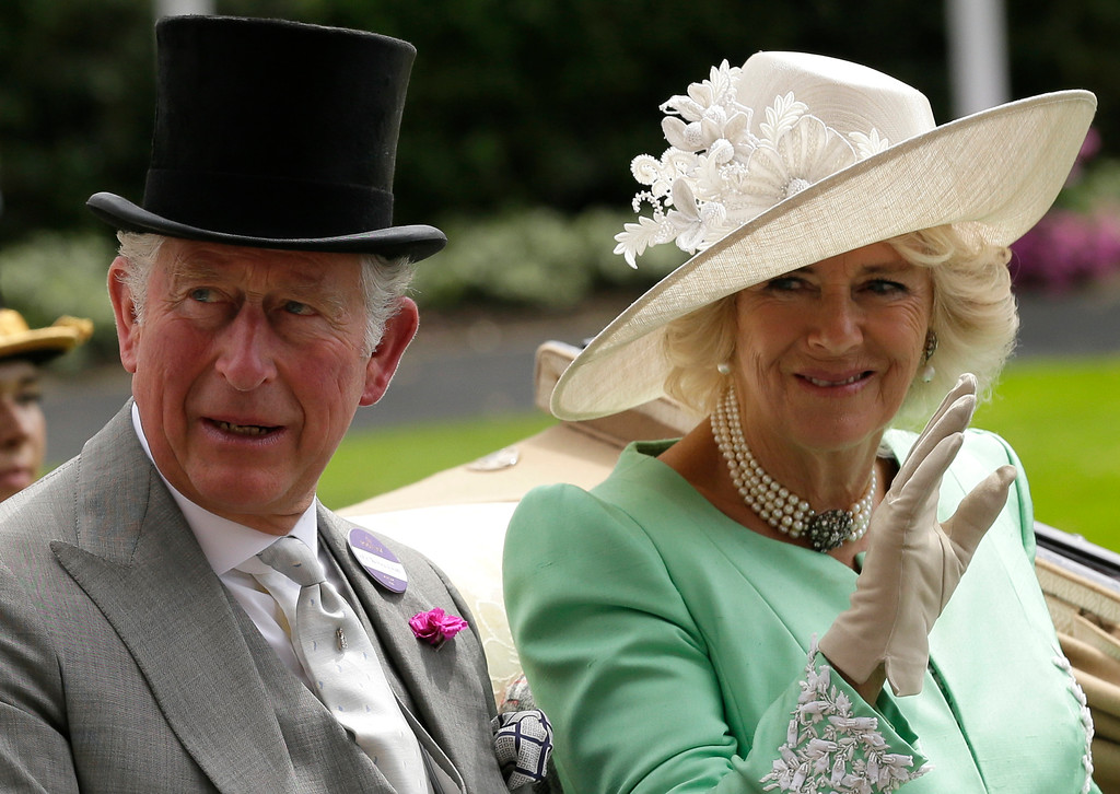 . The Prince of Wales and the Duchess of Cornwal arrive at the parade ring in a horse drawn carriage, on the second day of the Royal Ascot horse race meeting in Ascot, England, Wednesday, June 20, 2018. (AP Photo/Tim Ireland)
