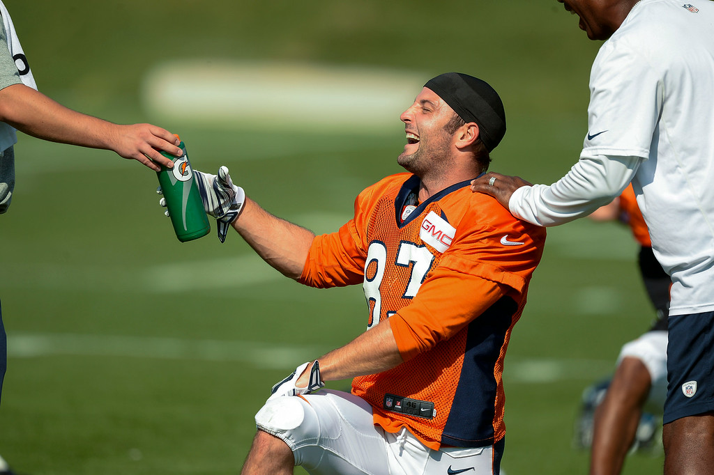 . Denver Broncos wide receiver Wes Welker (83) laughs during stretching on day five of the Denver Broncos 2014 training camp July 28, 2014 at Dove Valley. (Photo by John Leyba/The Denver Post)
