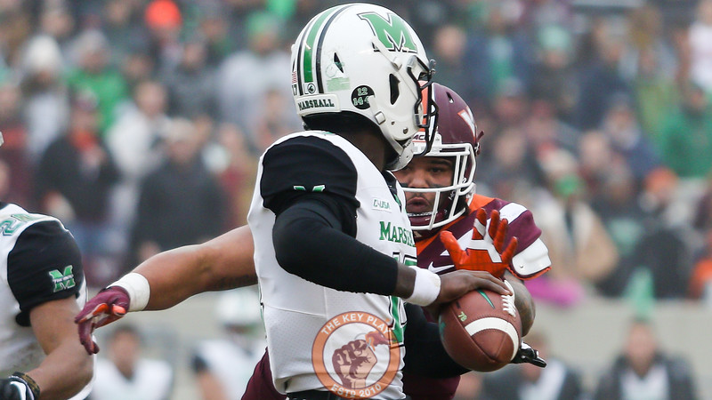 DT Ricky Walker pressures Marshall QB Isaiah Green in the first quarter. (Mark Umansky/TheKeyPlay.com)