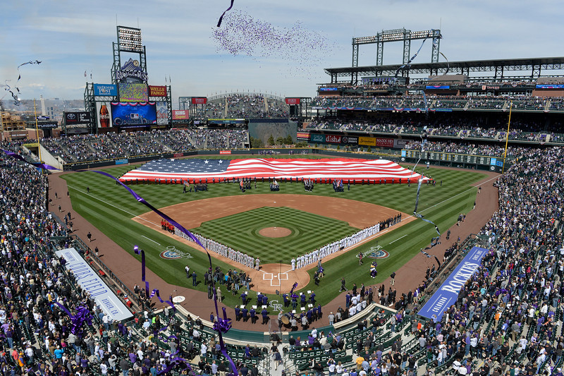 . Opening ceremonies featuring a giant American flag, fireworks and streamers kicked off the game. The Colorado Rockies hosted the Arizona Diamondbacks in the Rockies season home opener at Coors Field in Denver, Colorado Friday, April 4, 2014. (Photo by Craig F. Walker/The Denver Post)