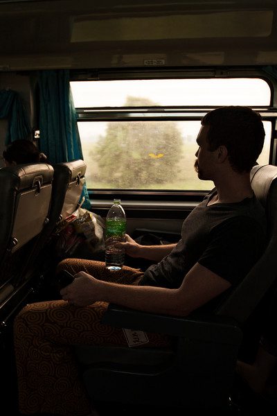 John gazes out the window of a train on our ride from Chiang Mai to Bangkok.